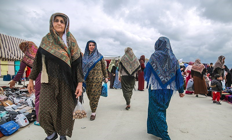 I spent my time visiting beautiful Turkmen women in their long, cheerful dresses and scarfs